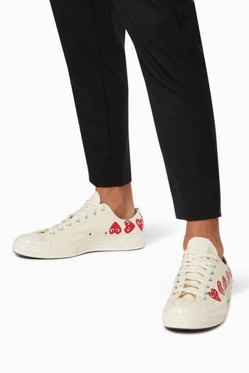 hover state of x Converse Chuck Taylor 70 Low-Top Sneakers