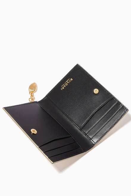 hover state of Serpenti Forever Fold Card Holder in Molten Karung